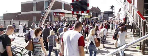 Swarms of people were filmed waiting at the crossing, rather than using the new £12 million bridge.