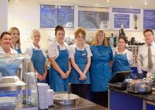 Managing director Mr Robert Miller with staff at Hemswell Antique Centres coffee shop in Building One.