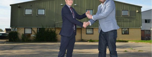 YPP Managing Director Stuart Maclaren receives the keys to the new company HQ from Tim Gutteridge of Lambert Smith Hampton