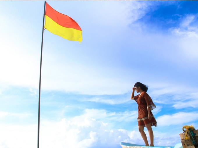 Knee-length beach cover-up made using a chiffon sari.
