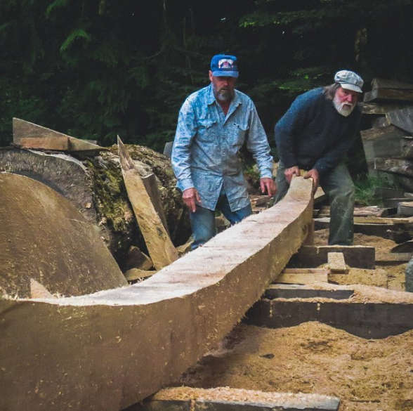 Jay Smith (right) examines the keel (Susan Wood via Instagram)