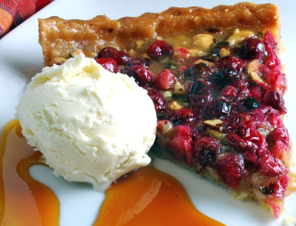 Cranberry hazelnut tart slice with ice cream Hazelnut Honey Toffee Tart with Cranberry Variation
