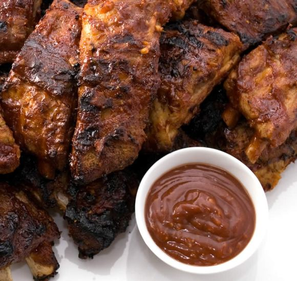 Ribs fresh from the grill Grilled Baby Back Ribs with Garlic Ginger BBQ Glaze