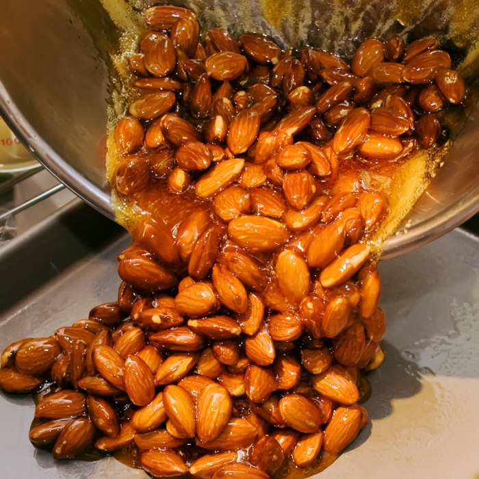Almond Praline Pouring Out Onto Sheet Pan