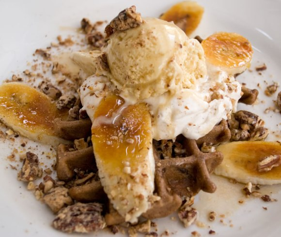Zinc Bistro Warm Cinnamon Waffles with Candied Pecans, Brûléed Bananas & Rum Maple Glaze