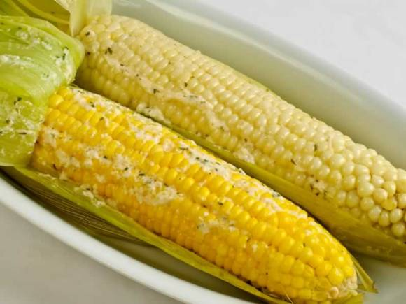 White and yellow corn serving Sweet Corn Grilled in the Husk