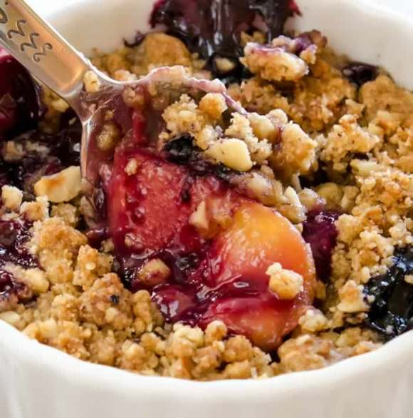 Ginger Lime Peach Blueberry Crisp with Toasted Hazelnut Streusel Closeup Ginger Lime Peach & Blueberry Crisp with Toasted Hazelnut Streusel