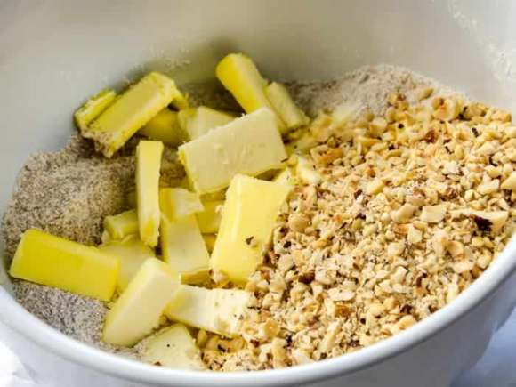 Preparing Toasted Hazelnut Streusel Ginger Lime Peach & Blueberry Crisp with Toasted Hazelnut Streusel