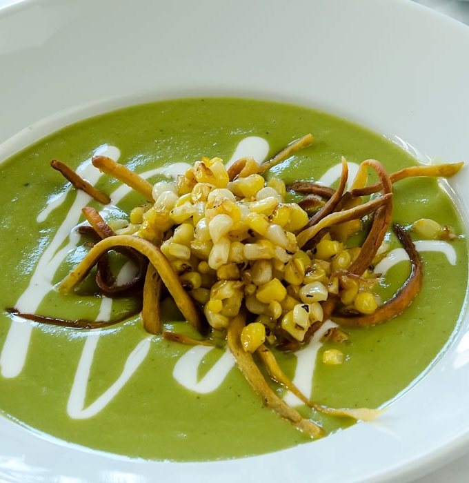 Roasted Green Chile Soup with Mexican Crèma, Frizzled Tortillas & Charred Sweet Corn