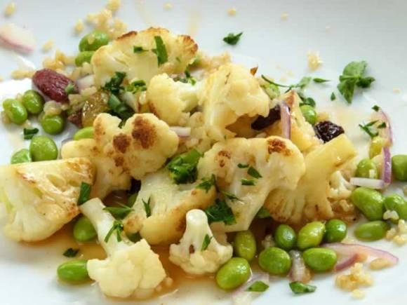 Serving 2 Warm Cauliflower Salad with Edamame & Raisins