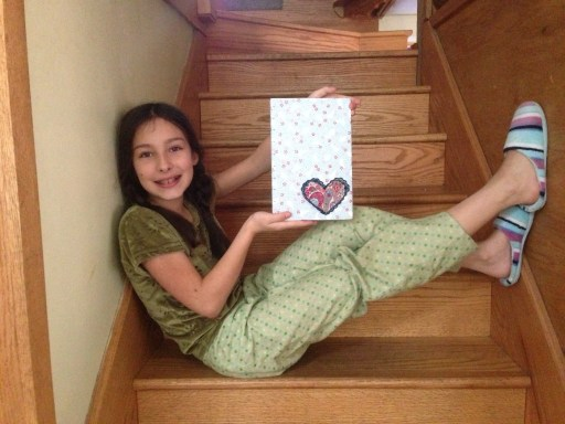 my daughter showing off her new journal