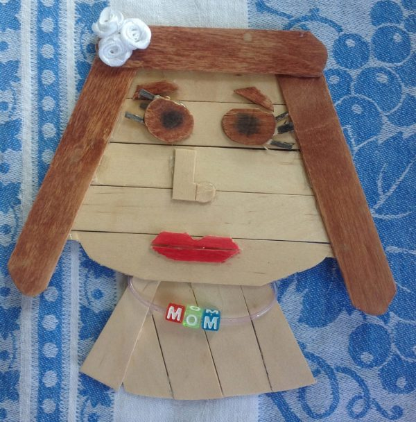 The popsicle stick rendering of Mom, made by my youngest, Lilly