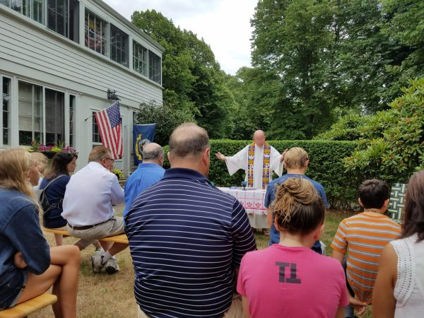 Father Joe celebrating mass in our front yard at the end of our military retirement weekend.