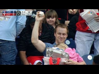 WOW, This Dad Catches A Foul Ball With His Daughters In Arms