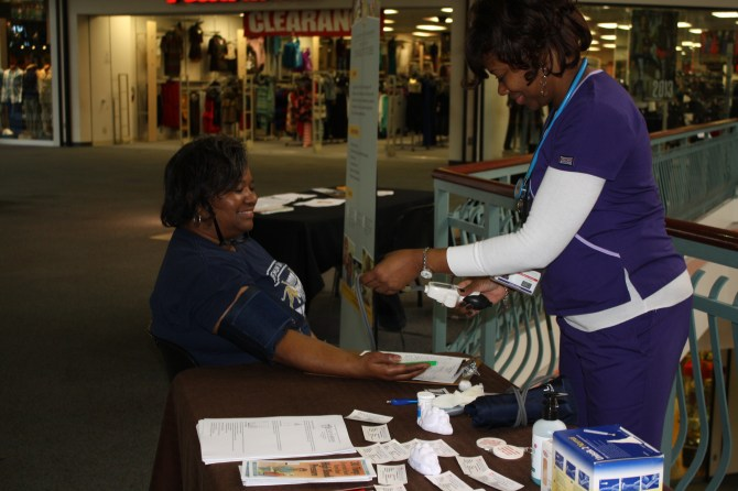 Jennifer Jackson, a nurse with Jackson-Hinds Comprehensive Health Center, checks Althea L. Ford's blood pressure.
