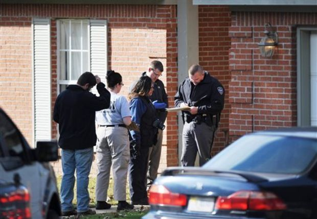 Oxford Police and the Mississippi Bureau of Investigation investigate a scene in Oxford, Miss., Friday, Nov. 8, 2013. Carol Lavett Gary, 43, and her 12-year-old son, Patrick Earl Gary Jr., were found shot to death Friday. (AP Photo/Oxford Eagle, Bruce Newman)