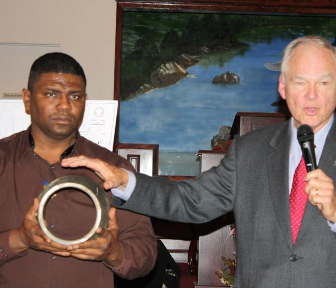 Willie C. Bell, Interim Director of Public Works, and W. Hibbett Neel, President of Neel-Schaffer with new pipe