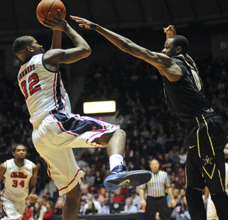Mississippi's Jarvis Summers (32) shoots over Vanderbilt's Rod Odom (0) during an NCAA college basketball game in Oxford, Miss., Saturday, March 8, 2014. (AP Photo/Oxford Eagle, Bruce Newman)