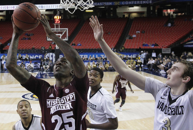 Mississippi State forward Roquez Johnson (25) shoots as Vanderbilt forward Luke Kornet (3) looks on during the second half in a first round Southeastern Conference tournament game, Wednesday, March 12, 2014, in Atlanta. Mississippi State won 82-68. (AP Photo/John Bazemore)