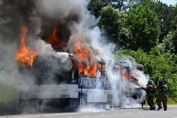 No one was injured with the Jackson State University baseball team's bus erupted into flames along I-20/59 eastbound in Midfield, Monday, May 5, 2014. (Contributed photo / Bruce Thomas)