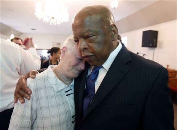 Rita Schwerner-Bender, widow of Michael Schwerner, one of three civil rights workers murdered in Neshoba County for their work in trying to register blacks to vote in then segregationist Mississippi, hugs U.S. Rep. John Lewis, D-Ga., a one-time Freedom Rider, during a commemorative service at Mt. Zion United Methodist Church in Philadelphia, Miss., Sunday, June 15, 2014. (AP Photo/Rogelio V. Solis)