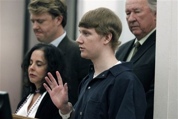 Surrounded by his attorneys, Deryl Dedmon, 19, swears before Hinds County Circuit Judge Jeff Weill Sr., that he has willingly entered a guilty plea to murder and committing a hate crime in the June 2011 death of James Craig Anderson, a black man, Wednesday, March 21, 2012 in Hinds County Circuit Court, in Jackson, Miss. The teenager's charges stemmed from running over Anderson with his pickup truck. Dedmon was sentenced to two concurrent life sentences. (AP Photo/Rogelio V. Solis, Pool)