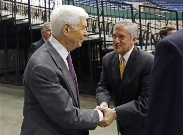 Democratic Senate candidate Travis Childers, right, shakes the hand of his main opponent, Republican U.S. Sen. Thad Cochran after speaking at the Hobnob, a casual gathering of business people at the Mississippi Coliseum, in Jackson, Miss., Wednesday, Oct. 29, 2014. Reform Party candidate Shawn O'Hara is also in the Senate race. (AP Photo/Rogelio V. Solis)
