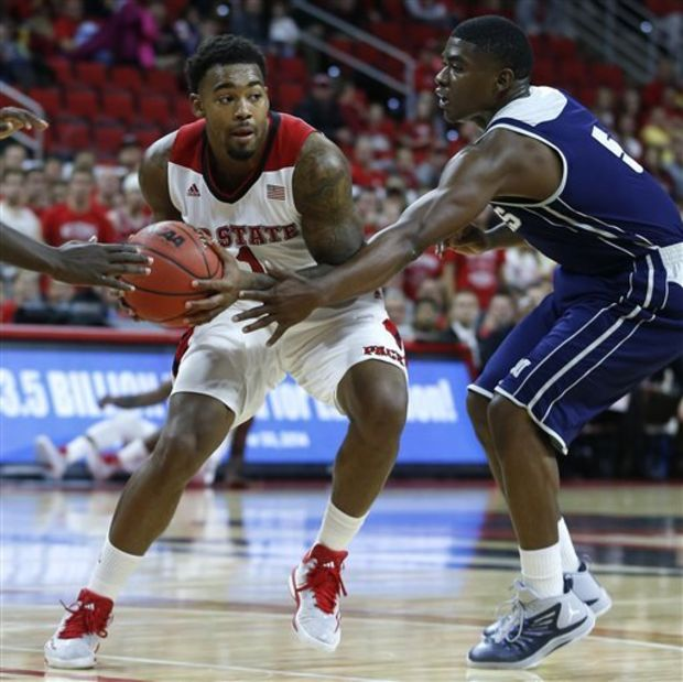North Carolina State's Trevor Lacey (1) looks for room around Jackson State's Jaleel Queary (5) during the first half of an NCAA college basketball game in Raleigh, N.C., Friday, Nov. 14, 2014. (AP Photo/The News & Observer, Ethan Hyman)