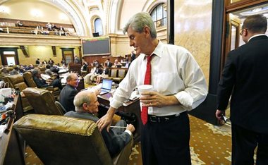In this file photo, Gov. Phil Bryant visits the House chambers in the Mississippi Capitol. A $2.5 billion education funding bill is heading to his desk and Bryant says he will sign it. Rogelio V. Solis/The Associated Press