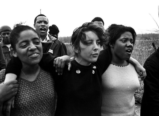 """Young marchers sing freedom songs during the Selma-to-Montgomery march for voting rights in March 1965. (The Birmingham News file/James """"Spider"""" Martin)"""