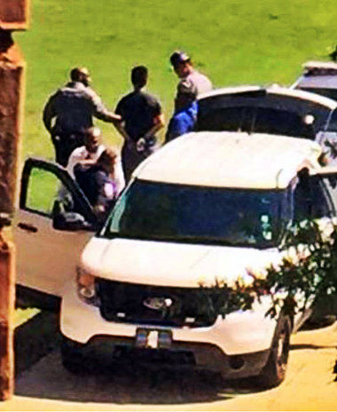 This photo shows a Mississippi State University freshman being taken into custody after he made theats of suicide and homicide on the MSU campus Thursday morning. Twitter photo
