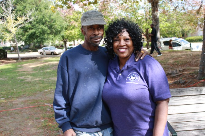 Pastor Sandra Vaughn Rucker greets Nathan Jefferson at Smith Park Saturday.