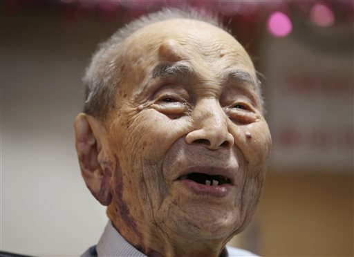 In this Aug. 21, 2015 file photo, Yasutaro Koide smiles upon being formally recognized as the world's oldest man by the Guinness World Records at a nursing home in Nagoya, central Japan. The world's oldest man has died at the age of 112, two months short of his 113th birthday. The Ministry of Health, Labor and Welfare said he died early Tuesday, Jan. 19, 2016. Koji Sasahara/The Associated Press