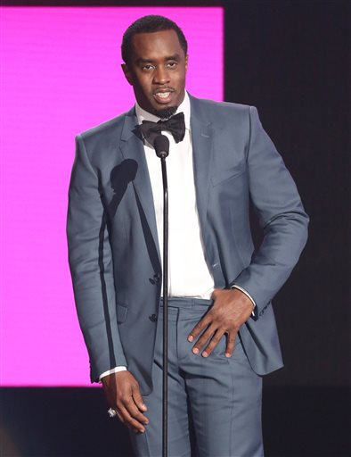 """In this Nov. 22, 2015, file photo, Sean """"Diddy"""" Combs presents the award for best collaboration of the year at the American Music Awards in Los Angeles. Combs, the founder of Capital Preparatory Harlem Charter School, announced Monday, March 28, 2016, that the school will open in the fall of 2016. (Photo by Matt Sayles/Invision/AP, File)"""