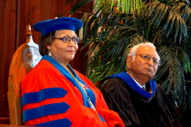Tougaloo College President Beverly Hogan and Asoka Srinivasan, interim provost and vice president for Academic Affairs, listen during services. PHOTOS BY JAY JOHNSON