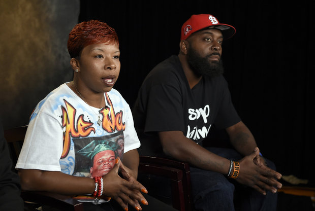 In this Sept. 27, 2014 file photo, the parents of Michael Brown, Lesley McSpadden, left, and Michael Brown, Sr., right, sit for an interview with The Associated Press in Washington. Attorneys representing Ferguson, Mo., its former police chief and an ex-officer in a wrongful-death lawsuit by Brown's parents are pressing the latest quest for access to any of the late 18-year-old's juvenile records. Anthony Gray, a Brown family attorney, has said any brush by Brown with the juvenile court system is irrelevant to whether Brown's 2014 death resulted from excessive police force. (AP Photo/Susan Walsh, File)
