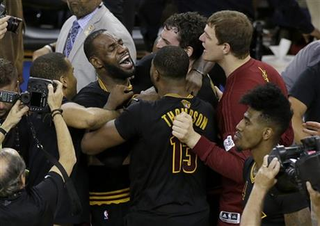 Cleveland Cavaliers forward LeBron James, top left, celebrates with teammates after Game 7 of basketball's NBA Finals against the Golden State Warriors in Oakland, Calif., Sunday, June 19, 2016. The Cavaliers won 93-89. (AP Photo/Eric Risberg)