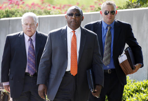 Former Mississippi Corrections Commissioner Chris Epps, center, and his attorneys, walk to the federal courthouse for a hearing in Jackson, Miss., Thursday, June 9, 2016. The hearing is on evidence of how much the bribes taken by Epps cost Mississippi's taxpayers. That determination, in turn, will influence how long Epps spends in prison for money laundering and filing false tax returns related to $1.4 million in bribes prosecutors say he took. (Rogelio V. Solis/The Associated Press)