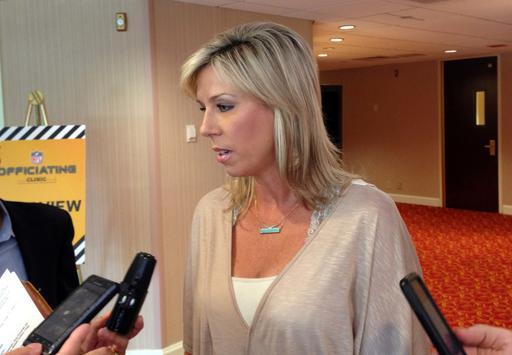 Sarah Thomas, the first female to be a full-time game official in the NFL, talks with reporters about her first season while at the annual NFL Officiating Clinic on Friday, July 15, 2016, in Irving, Texas. Thomas will again be the NFL's only female game official in 2016. (Stephen Hawkins/The Associated Press)