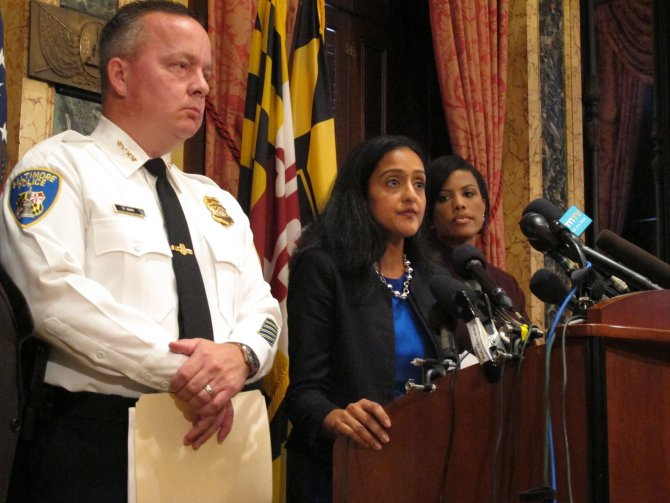 Vanita Gupta, head of the Justice Department's Civil Rights Division, discusses the department's findings on the investigation into the Baltimore City Police Department as Police Commissioner Kevin Davis, left, and Mayor Stephanie Rawlings-Blake, right, listens on Wednesday, Aug. 10, 2016 at City Hall in Baltimore. Brian Witte / AP