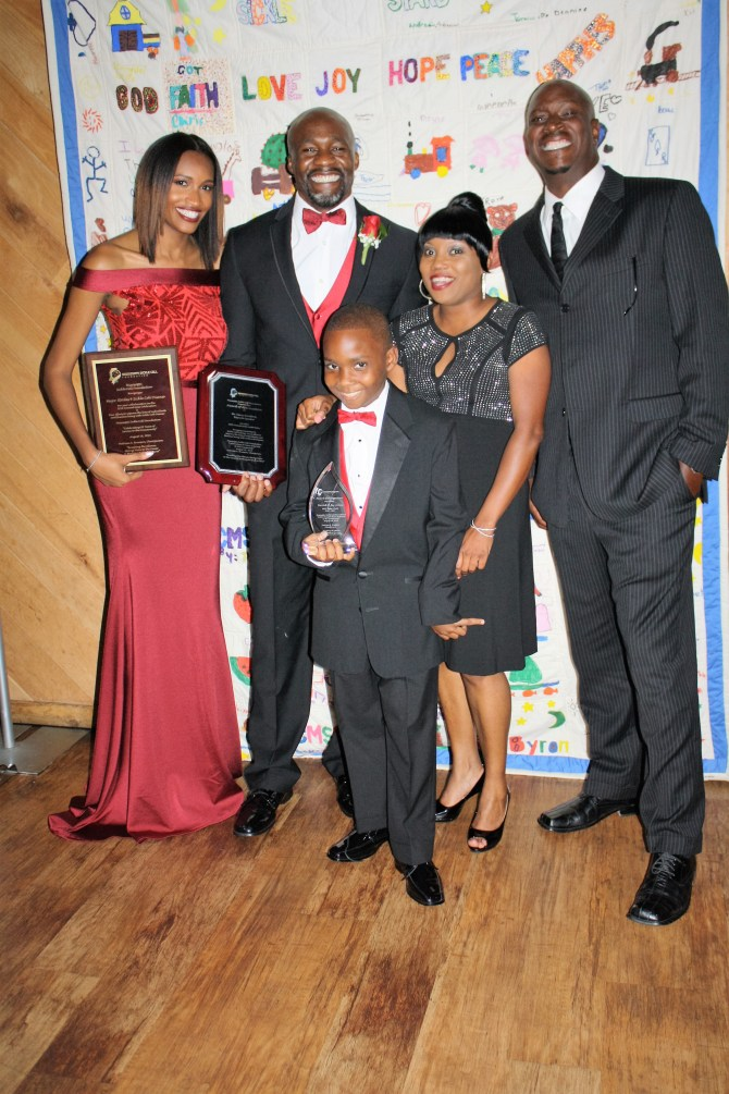 "Attending the Mississippi Sickle Cell Foundation Gala were Derrick ""DJay"" James (front), MSCF Poster Child for 2016; La'Shon O'Neal (back row, from left), Corey Bradford, LaShaunda Davenport (DJay's mom) and Derrick James (DJay's father). PHOTO BY STEPHANIE R. JONES"