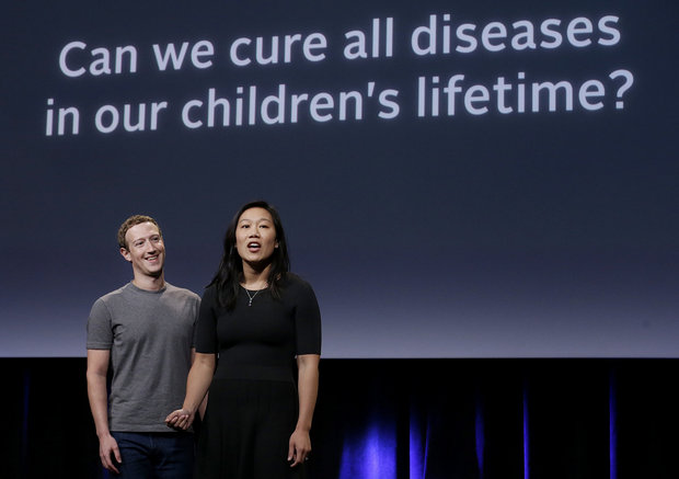 Facebook CEO Mark Zuckerberg and his wife, Priscilla Chan, have a new lofty goal: to cure, manage or eradicate all disease by the end of this century. (Jeff Chiu / AP)