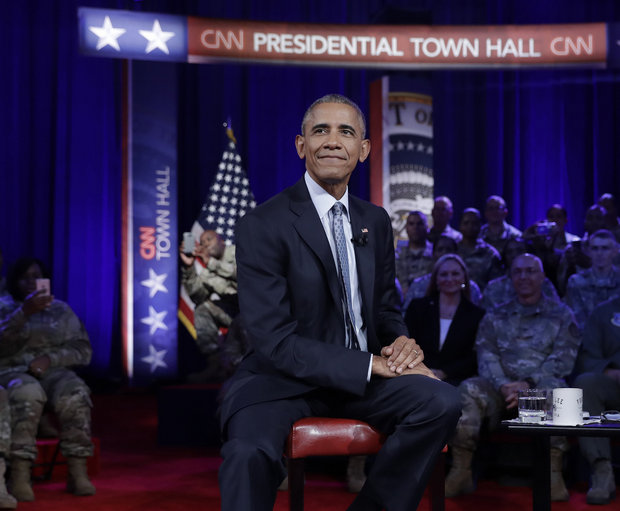 President Barack Obama takes a break from his CNN town hall meeting with CNN news anchor Jake Tapper on Wednesday, September 28, 2016. (Carolyn Kaster / AP)