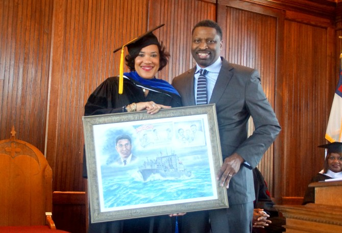 Karen Weaver is shown with Derrick Johnson, who presented her a protriat of Medger Wiley Evers and the ship named in his honor on behalf of the MS State Conference NAACP. PHOTO BY JAY JOHNSON