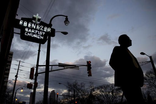 A man walks past Ebenezer Baptist Church, early Monday in Atlanta, before the Rev. Martin Luther King Jr. holiday commemorative service. The Rev. Bernice King, Martin Luther King Jr.'s daughter, urged Americans during the service to honor her father's legacy regardless of who occupies the Oval Office. (Branden Camp/The Associated Press)