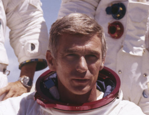 In an undated file photo provided by NASA, US Navy Commander and Astronaut for the upcoming Apollo 17, Eugene Cernan, is pictured in his space suit. NASA announced that former astronaut Cernan, the last man to walk on the moon, died Monday, Jan. 16, 2017, surrounded by his family. He was 82. (NASA photo)