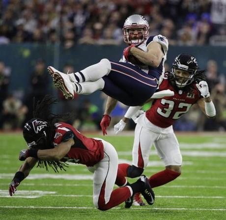New England Patriots' Julian Edelman is upended by Atlanta Falcons' Philip Wheeler, bottom, during the first half of the NFL Super Bowl 51 football game Sunday, Feb. 5, 2017, in Houston. (AP Photo/Jae C. Hong)