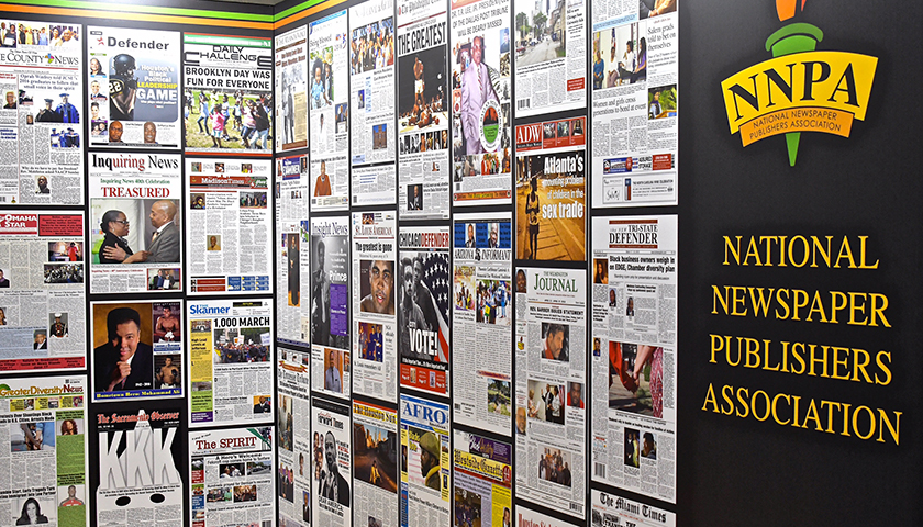 A display wall showcases the front pages of the nation's Black newspapers. (Travis Riddick/NNPA)