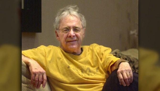 "FILE - In this Dec. 20, 2002 file photo, Chuck Barris, the man behind TV's ""The Dating Game,"" poses in the lobby of his apartment in New York. Game show impresario Barris has died at 87. Barris, the madcap producer of ""The Gong Show"" and ""The Dating Game,"" died of natural causes Tuesday afternoon, March 21, 2017, at his home in Palisades, New York. (AP Photo/Bebeto Matthews, File)"