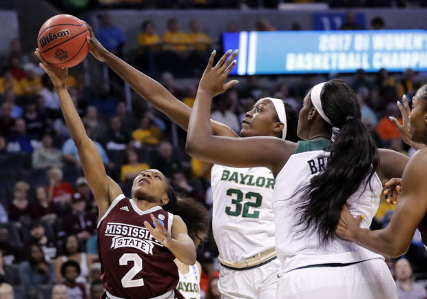 Mississippi State's Morgan William (2) scored 12 points in overtime and finished with 41 for the game as the Bulldogs beat the Baylor Bears 94-85 on Sunday to clinch Mississippi State's first Final Four berth in program history. (Alonzo Adams/AP)
